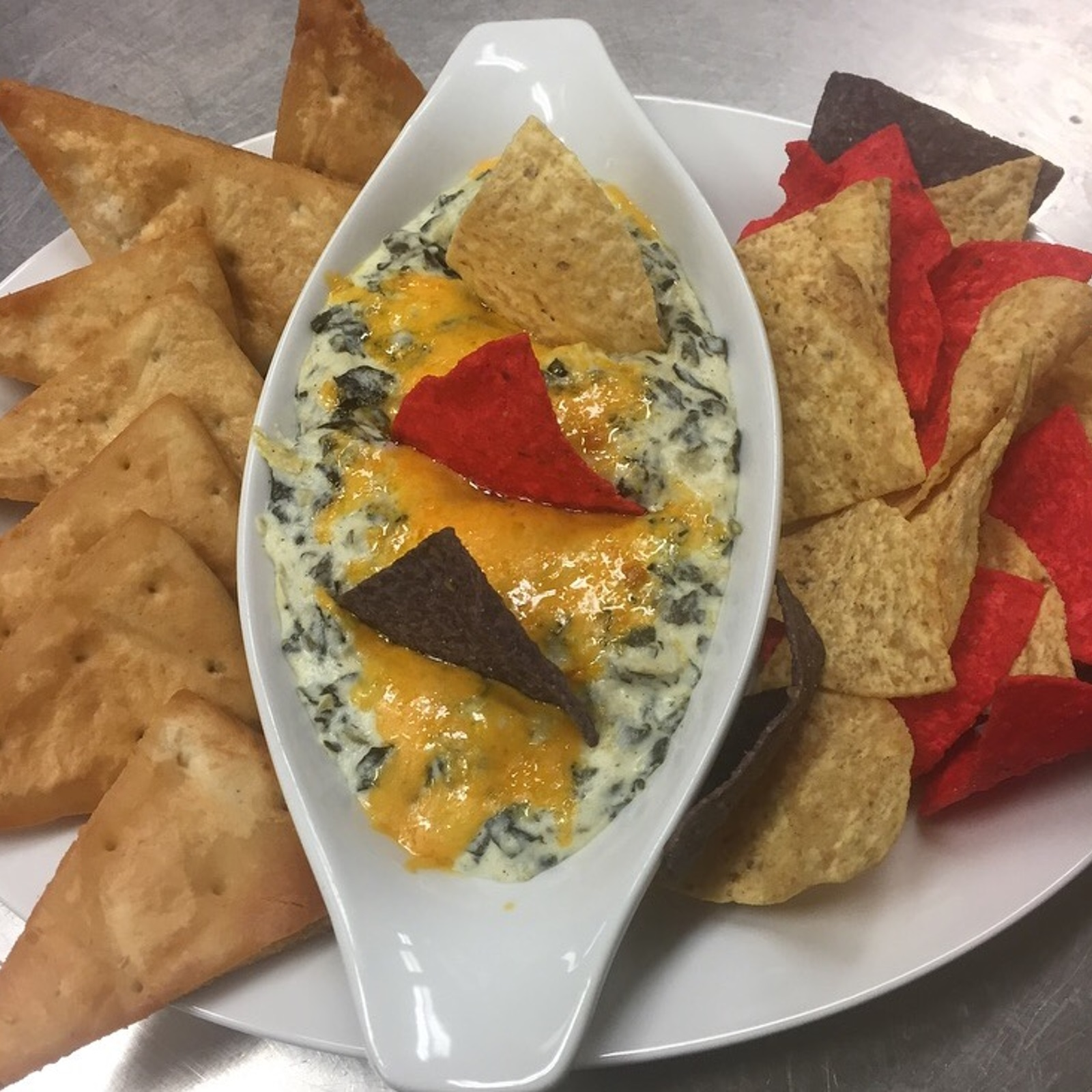 Picture of nachos and pita bread with dip