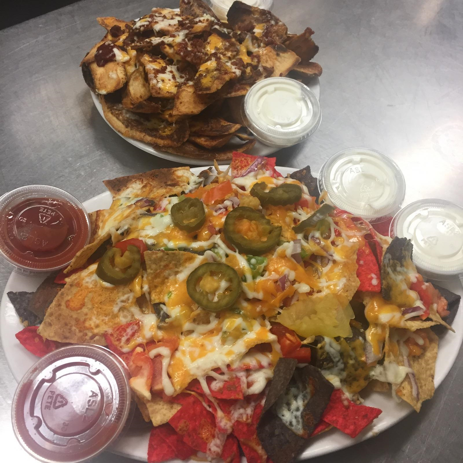 Picture of nachos and potato skins